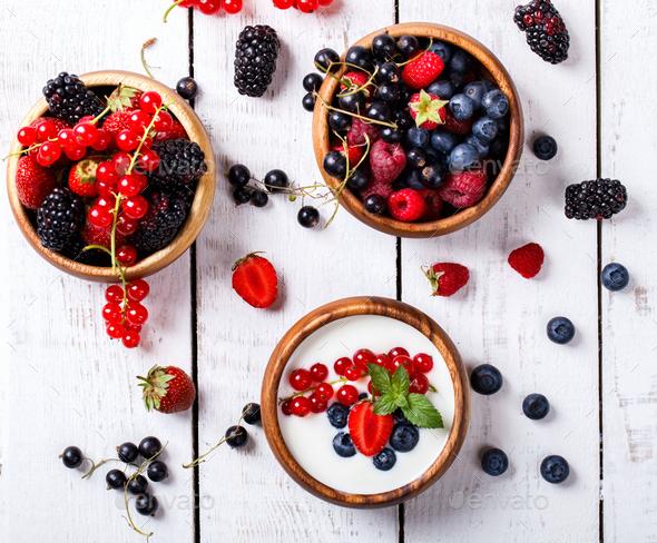Homemade Yogurt,bowl with different berries,blackberries, strawberries,red currants,raspberries - Stock Photo - Images