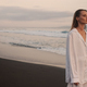 Attractive girl walking by the ocean at dusk. Beautiful model resting on paradise island - PhotoDune Item for Sale