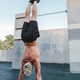 Handstand yoga pose by athlete man on the sport ground outdoors, natural lifestyle photo. - PhotoDune Item for Sale