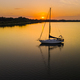 Lonely yacht anchored in a bay at sunset - PhotoDune Item for Sale