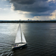 Yacht sailing at sunset during a storm. Luxury vacation at sea - PhotoDune Item for Sale