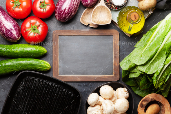 Cooking utensils, ingredients and chalkboard - Stock Photo - Images