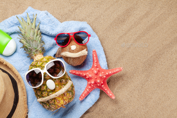 Pineapple and coconut with sunglasses - Stock Photo - Images