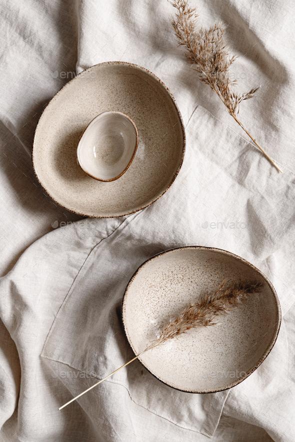 Modern minimalist ceramics set over a linen cloth. - Stock Photo - Images