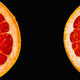 Fresh red grapefruit cut in half on black background - PhotoDune Item for Sale