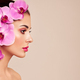 Portrait of beautiful young woman with orchid - PhotoDune Item for Sale