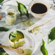 Green matcha cheesecake and black coffee in cup, selective focus - PhotoDune Item for Sale