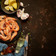 Seafood composition with shrimps or prawns. Seved on dark background with many ingredients. Flat lay - PhotoDune Item for Sale