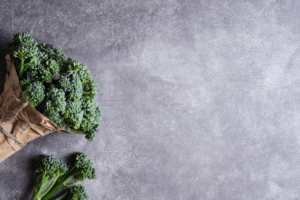 Bunch of Broccolini on Stone Background. - Stock Photo - Images