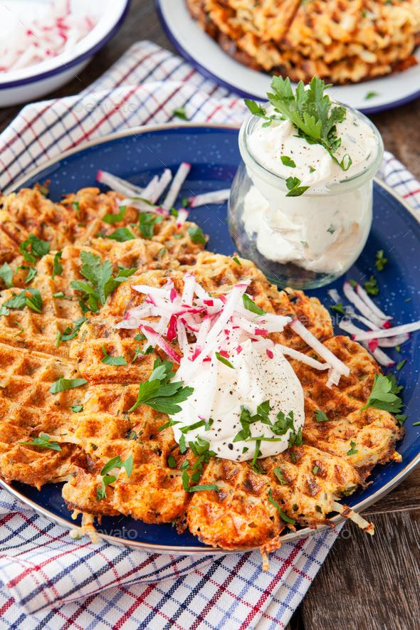 Potato pancakes with sour cream - Stock Photo - Images