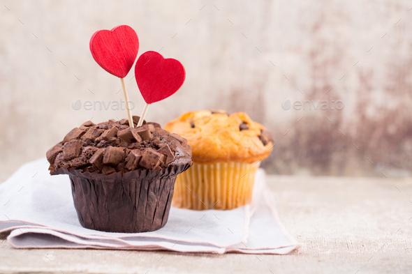 Homemade chocolate muffins with heart, vintage background. - Stock Photo - Images