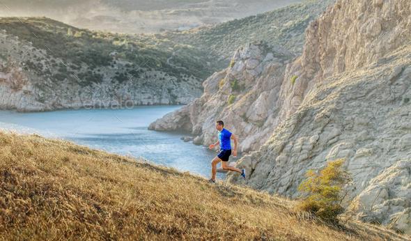 man athlete running uphill - Stock Photo - Images