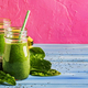 Green smoothies in glass bottles on cool pink blue background - PhotoDune Item for Sale