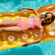 Little girl in sunglasses relaxing in swimming pool, swims on inflatable yellow mattres - PhotoDune Item for Sale