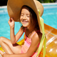 Little girl relaxing in swimming pool, swims on inflatable yellow mattres - PhotoDune Item for Sale