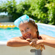 A cute happy young girl child playing in swimming pool wearing blue diving mask - PhotoDune Item for Sale