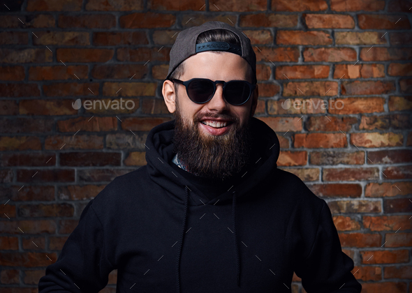 Tattooed bearded male in military jacket. - Stock Photo - Images