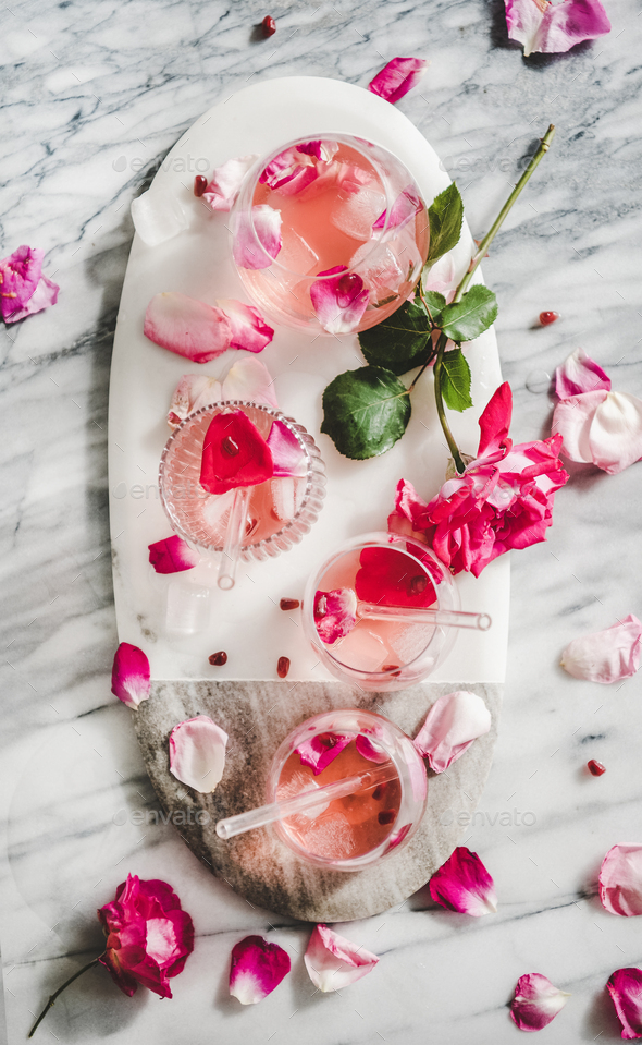 Rose lemonade with ice cubes and pink rose petals - Stock Photo - Images