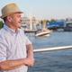 Hispanic man standing on seaside on a sunny day - PhotoDune Item for Sale