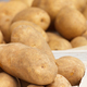 Heap of potatoes in wooden box, healthy nutrition concept - PhotoDune Item for Sale