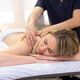 Woman lying on a stretcher receiving a back massage - PhotoDune Item for Sale