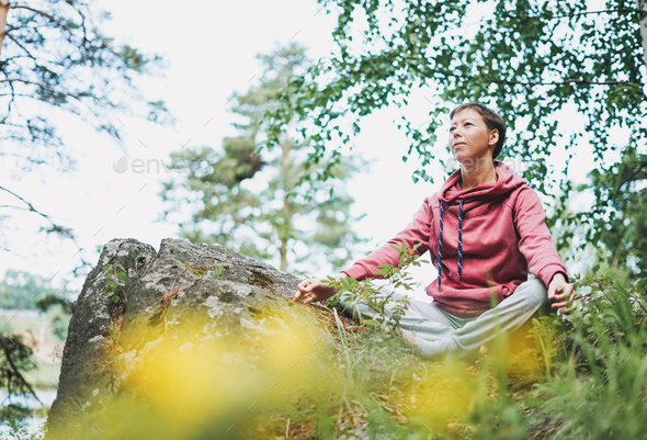 Young smiling woman practice yoga outdoors - Stock Photo - Images