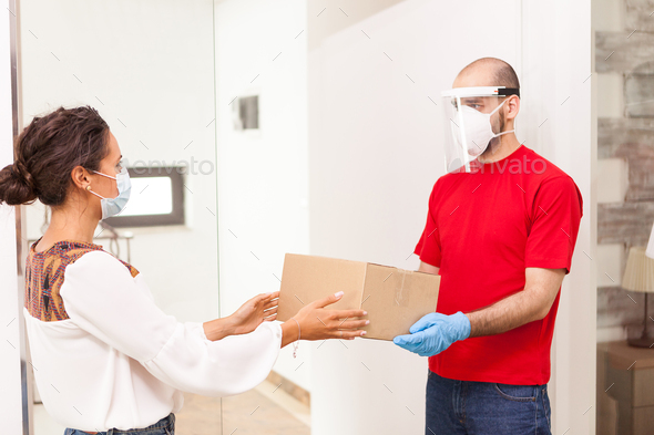 Delivery man and customer - Stock Photo - Images
