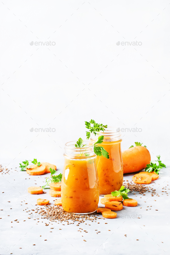 Carrot smoothie or juice with linen seeds, healthy and useful drink - Stock Photo - Images