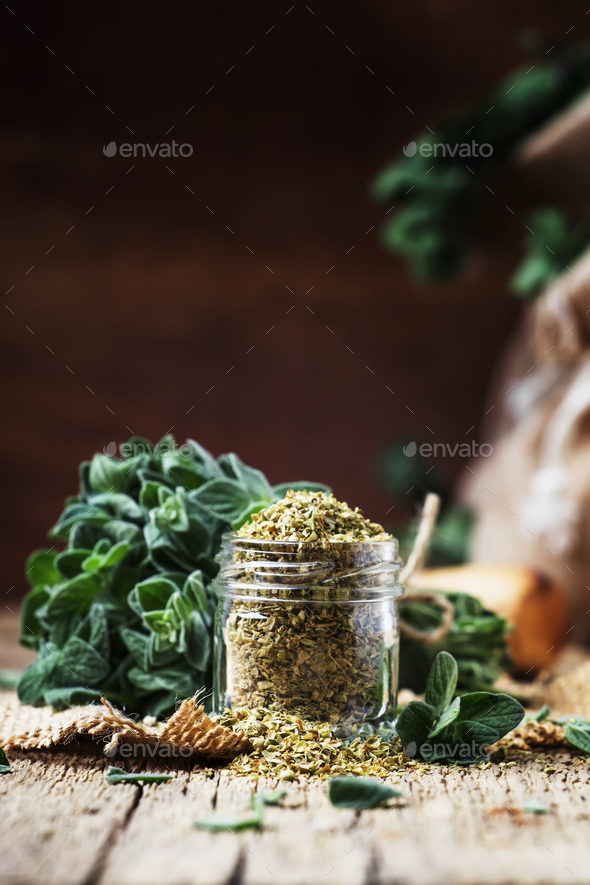 Dried and fresh oregano, vintage wood background, rustic style - Stock Photo - Images