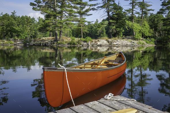 Canoe on Ontario lake - Stock Photo - Images