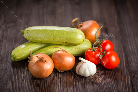 Vegetables on a dark wooden background - Stock Photo - Images