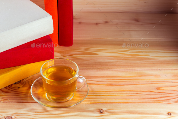 Cup of tea and books onwooden background - Stock Photo - Images