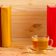 Cup of tea and books onwooden background - PhotoDune Item for Sale