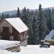Wooden houses on a background of snowy forest - PhotoDune Item for Sale