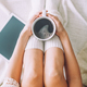 Closeup of woman's legs on the bed. Young woman enjoys her stay at home. - PhotoDune Item for Sale