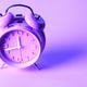 purple alarm clock on neon purple background. Minimal concept - PhotoDune Item for Sale