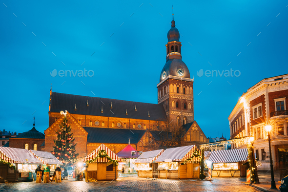 Riga, Latvia. Christmas Market On Dome Square With Riga Dome Cathedral. Christmas Tree And Trading - Stock Photo - Images