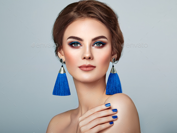 Beautiful Woman with Large Earrings Tassels - Stock Photo - Images