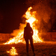 Silhouette of a woman in front of a giant bonfire - PhotoDune Item for Sale