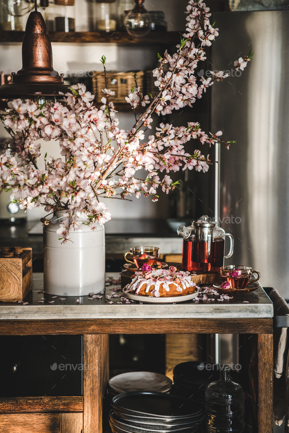 Rose and almond gluten-free bundt cake with flowers and tea - Stock Photo - Images