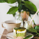 Green matcha cheesecake and black coffee on kitchen counter - PhotoDune Item for Sale
