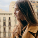Beautiful sensual girl thoughtfully looking away on balcony with beautiful view on architecture - PhotoDune Item for Sale