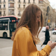 Attractive girl at crossroads using smartphone for navigating in city streets - PhotoDune Item for Sale