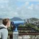 man looking through stationary binoculars - PhotoDune Item for Sale