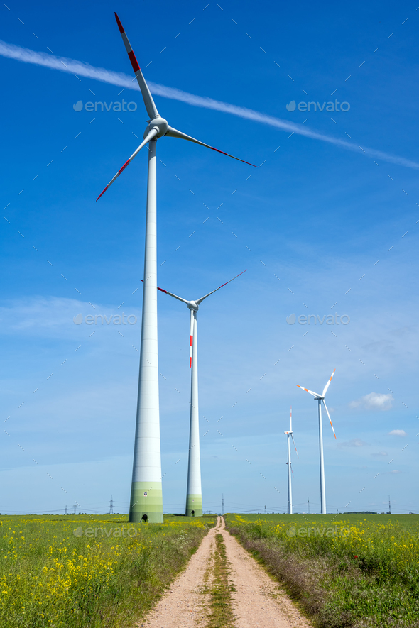 Modern wind energy generators and a country road - Stock Photo - Images