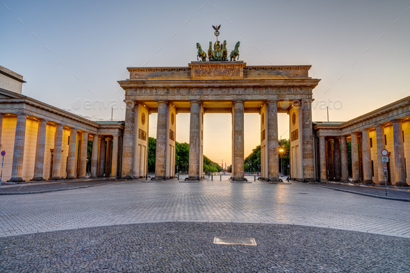 The illuminated Brandenburg Gate in Berlin - Stock Photo - Images