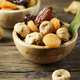 Sweet italian dried figs, apricots and dates on the wooden table - PhotoDune Item for Sale