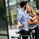 Couple in love with dog walking and smiling outdoor - PhotoDune Item for Sale