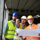 Confident team of architects and engineers working together on construction site - PhotoDune Item for Sale