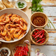 Top view of prawns shrimps roasted on pan with herbs placed on rustic wooden kitchen table - PhotoDune Item for Sale